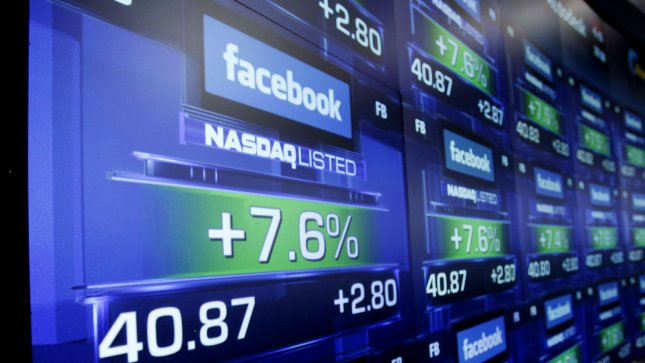 The board shows a small gain as Facebook begins trading after at the Nasdaq in Times Square in New York City on May 18, 2012. Facebook begins trading publicly for the first time today under the symbol (FB). UPI/John Angelillo