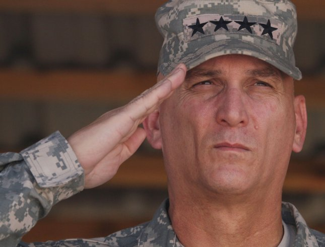 Commander of U.S. forces in Iraq Gen. Ray Odierno salutes at the end of mission ceremony at the military Camp Echo in Diwaniyah, 130 kilometers (80 miles) south of Baghdad, Iraq on October 4, 2008. (UPI Photo/Ali Jasim)