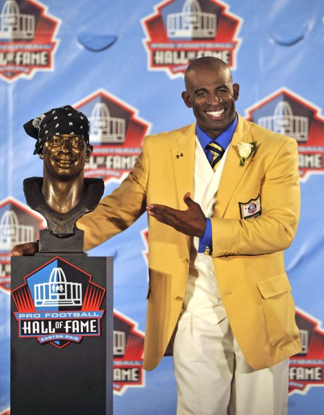 Deion Sanders poses with a bust of himself during the Pro Football Hall of Fame Enshrinement Ceremonies at Fawcett Stadium in Canton, Ohio, on August 6, 2011. UPI / David Richard