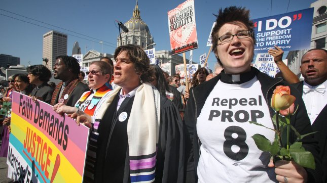 Demonstrators in favor of gay marriage await the California Supreme Court decision on state Proposition 8, a ballot initiative limiting marriage to a man and a woman, in front of City Hall in San Francisco on May 26, 2009. (UPI Photo/Terry Schmitt)