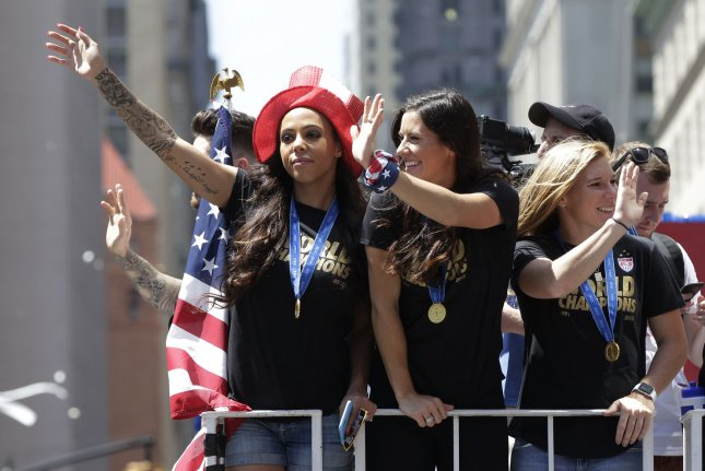 Players of the United States Women's Soccer team ride up the parade route when Mayor Bill de Blasio hosts a Canyon of Heroines Ticker-Tape Parade and Celebration in honor of the U.S. Women's Soccer Team following their victory in the FIFA World Championship in New York City on July 10, 2015. Following the Parade, the Mayor will host a special ceremony at City Hall to present members of the United States WomenÕs National Soccer Team with keys to the City. Photo by John Angelillo/UPI