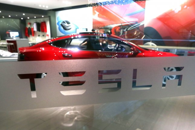 Tesla cars are on display in its flagship Tesla showroom in Beijing, China. The U.S. automaker denied reports of a production site after documents were leaked online. File Photo by Stephen Shaver/UPI