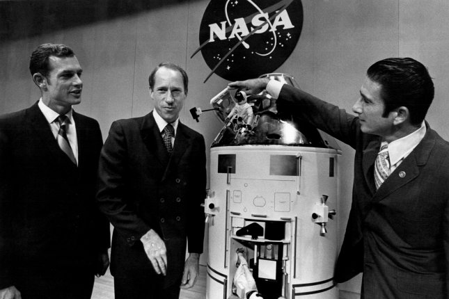 Apollo 15 astronauts David R. Scott (L) and Alfred M. Worden (C) watch James B. Irwin open the hatch on a model of the Apollo 15 command service module after a news conference at the Manned Spacecraft Center. On July 29, 1958, NASA was created. UPI File Photo