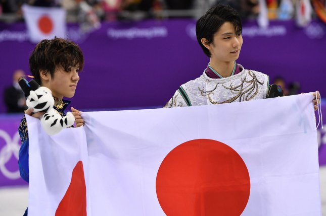 Gold medalist Yuzuru Hanyu of Japan, right, and silver medalist Shoma Uno of Japan during their victory lap for the Men's Single Skating Short Program during the Pyeongchang 2018 Winter Olympics Saturday at the Gangneung Ice Arena in Gangneung, South Korea. Photo by Richard Ellis/UPI
