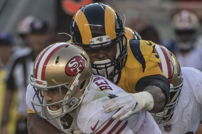 San Francisco 49ers quarterback C.J. Beathard is smothered by Los Angeles Rams defensive lineman Aaron Donald (99) in the fourth quarter on Sunday at Levi's Stadium in Santa Clara, California. Photo by Terry Schmitt/UPI