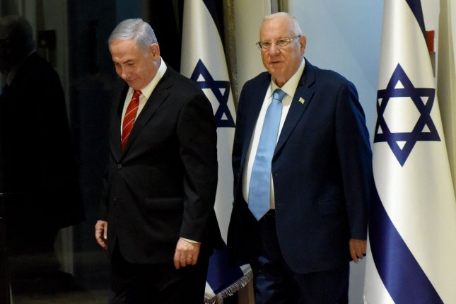 Israeli Prime Minister Benjamin Netanyahu (L) and Israeli President Reuven Rivlin arrive to speak with reporters on September 25 after Netanyahu was chosen to form the next government. Photo by Debbie Hill/UPI