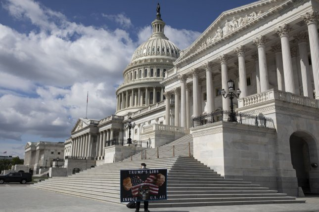 A lone protester stands in front of the U.S. Capitol in Washington, D.C., on May 12. The Senate convened Monday for the first time since the start of widespread national protests spurred by a police-involved death in Minnesota. Photo by Tasos Katopodis/UPI