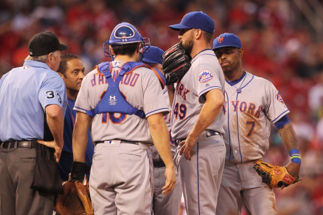 New York Mets starting pitcher Jonthon Niese talks with teammates just before leaving the game with an injury in the first inning against the St. Louis Cardinals at Busch Stadium in St. Louis on August 23, 2016. Photo by Bill Greenblatt/UPI