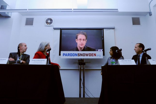 Edward Snowden speaks at a conference via a monitor at the September 14 launch of a campaign calling on President Barack Obama to pardon him before he leaves office. File Photo by Dennis Van Tine/UPI