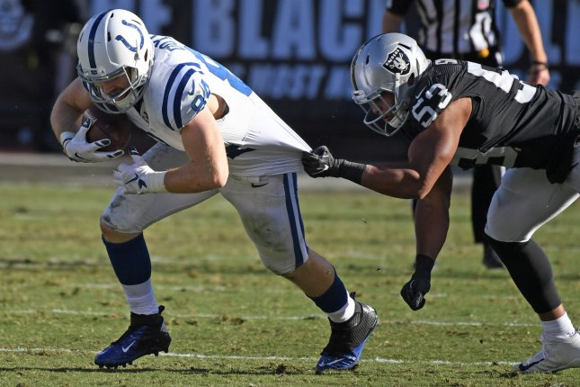 Indianapolis Colts TE Jack Doye (L) has his jersey tugged by Oakland Raiders Malcom Smith (53) in the second quarter at the Oakland Coliseum in Oakland, California on December 24, 2016. The Raiders won 33-25 but lost QB Derek Carr to a broken fibula. Photo by Terry Schmitt/UPI