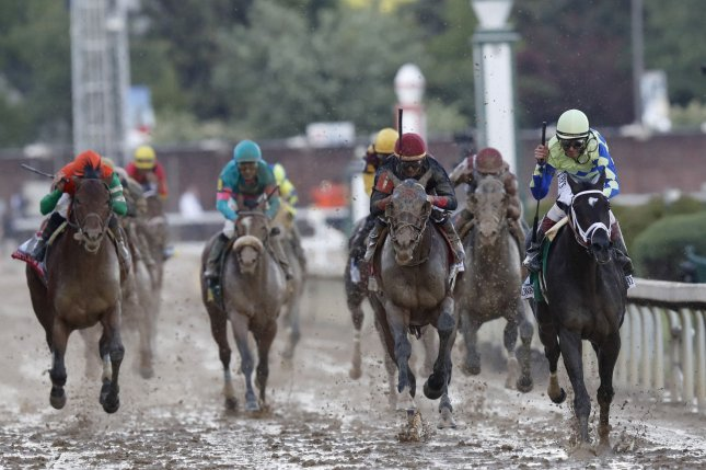 Jockey John Velazquez aboard Always Dreaming, right, celebrates winning the 143rd running of Kentucky Derby on Saturday at Churchill Downs in Louisville, Ky. Always Dreaming was the pre-race favorite. Photo by John Sommers II/UPI