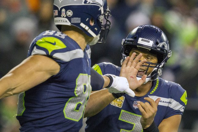 998a8d06197 Seattle Seahawks tight end Jimmy Graham (88) fist bumps quarterback Russell  Wilson (3) after their successful two-point conversion in the fourth  .quarter at ...