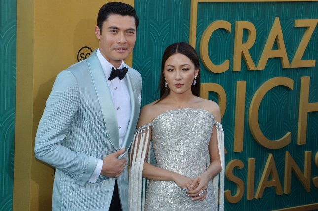 Crazy Rich Asians stars Henry Golding (L) and Constance Wu. The cast of the film is set to be honored at the Hollywood Film Awards. File Photo by Jim Ruymen/UPI