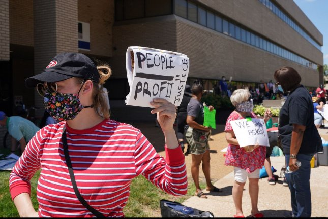 A teacher demonstrates during a protest outside the St. Louis Public School headquarters in St. Louis, Mo., on July 13. Teachers and faculty haven't been told what rules are in place for student and teacher safety when classes reopen on August 24. Photo by Bill Greenblatt/UPI