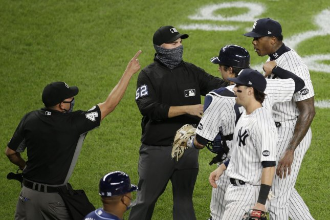 New York Yankees closer Aroldis Chapman (R) has to be restrained from approaching Tampa Bay Rays players Tuesday at Yankee Stadium in New York City. Chapman threw a fastball that came close to Mike Brosseau's head, which caused the benches to clear once the final out was recorded. Photo by John Angelillo/UPI