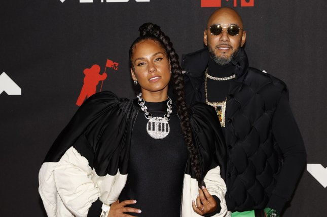Alicia Keys (L), and her husband, Swizz Beatz, arrive on the red carpet at the 38th annual MTV Video Music Awards in September 2021. Keys stars in her new music video for LaLa (Unlocked) along with Swae Lee, Snoop Dogg, Lena Waithe and more. File Photo by John Angelillo/UPI