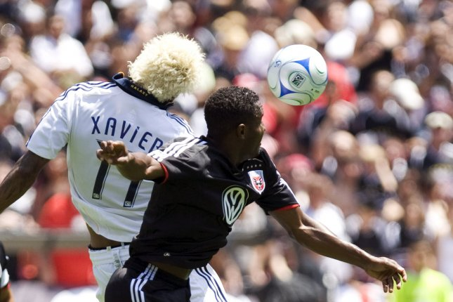 D.C. United's Luciano Emilio (11) and Los Angeles Galaxy's Abel Xavier (17) fight for the ball during the 1st half at RFK Stadium in Washington on June 29, 2008. DC United defeated the Los Angeles Galaxy 4-1. (UPI Photo/Patrick D. McDermott)