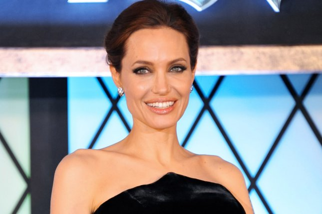 Actress Angelina Jolie is stepping behind the lens to direct Unbroken, Universal Pictures' upcoming film about Louis Zamperini's life as both an athlete and prisoner of war. UPI/Keizo Mori