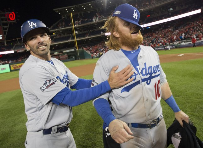 fe8cb917d Los Angeles Dodgers Justin Turner (R) celebrates after his two-run triple  in the seventh inning turned out to be the game winner against the  Washington ...