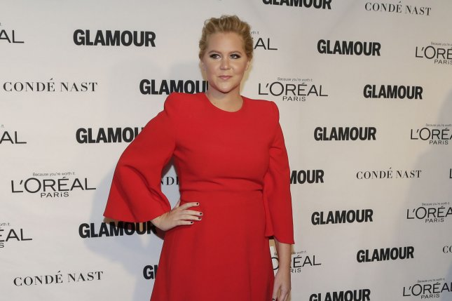 Amy Schumer arrives on the red carpet when Glamour Celebrates the 25th anniversary of the Woman of the Year Awards on November 9, 2015. Schumer has dropped out of an upcoming film based on Barbie from Sony and Mattel. File Photo by John Angelillo/UPI