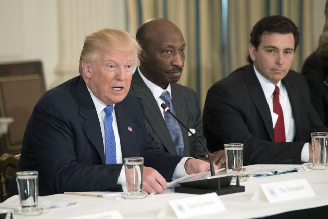 President Donald Trump, shown here meeting with manufacturing CEOs at the White House in February, on Wednesday disbanded his American Manufacturing Council and the Strategic and Policy Forum. File Photo by Kevin Dietsch/UPI