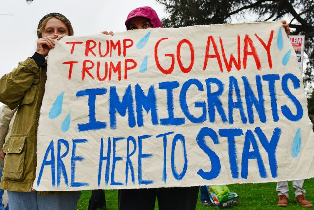 Protesters demonstrate against the Trump administration's crackdown on illegal immigration in Beverly Hills, Calif., on March 13. This week, the city of Albuquerque, N.M., voted to reaffirm its policy as a sanctuary city. File Photo by Christine Chew/UPI