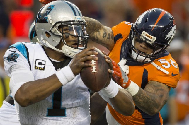 Denver Broncos linebacker Shane Ray (R) pressures Carolina Panthers quarterback Cam Newton in the first quarter on September 8, 2016 at Sports Authority Field at Mile High in Denver. File photo by Gary C. Caskey/UPI