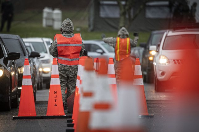 New Jersey Air Guard Airmen from the 108th Wing provide traffic control at a COVID-19 community-based testing site at the PNC Bank Arts Center in Holmdel, N.J., on Monday. Photo by Master Sgt. Matt Hecht/U.S. Air National Guard