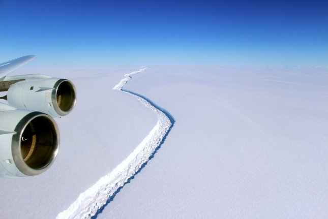 View of the rift across the Larsen C Ice Shelf as seen from the vantage point of NASA's DC-8 research aircraft on November 10, 2016. Scientists predict that even keeping global warming to a minimum under the Paris Agreement, enough of the Antarctic Ice Shelf will met to raise sea levels by 8.5 feet in the long-term. File Photo by John Sonntag/NASA