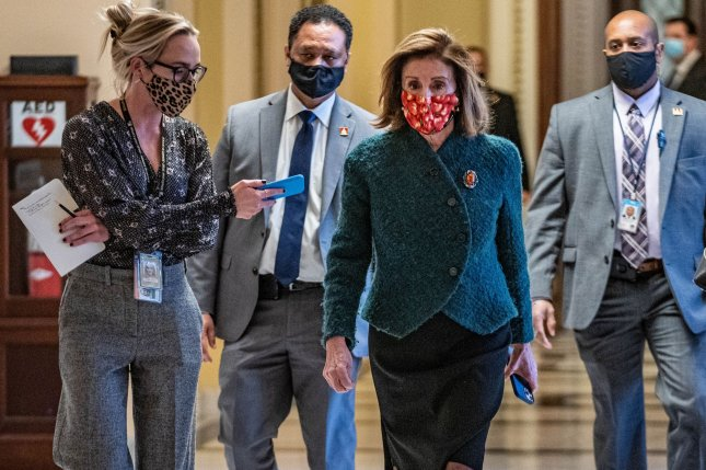 Speaker of the House Nancy Pelosi, D-Calif., walks from the House floor to her office on Monday as the House voted to increase a new round of stimulus payments to most Americans to $2,000. Photo by Ken Cedeno/UPI