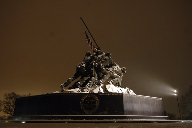The Iwo Jima Memorial is covered by snow in Arlington, Va., on January 28, 2007. On February 19, 1945, U.S. Marines landed on the island of Iwo Jima, opening one of the major battles in the Pacific during World War II. File Photo by Kevin Dietsch/UPI