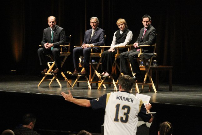 A St. Louis Rams fan wearing a Kurt Warner jersey makes his remarks in favor of the St. Louis Rams remaining in St. Louis during a town hall meeting at the Peabody Opera House in St. Louis on October 27, 2015. Representing the National Football League are (L to R) Chris Hardart, Eric Grubman, Cynthia Hogan and.Jay Bauman. The Rams owner Stan Kronke has hinted that he wants to move the team to Los Angeles. Town hall meetings are also scheduled for Oakland and San Diego. Photo by Bill Greenblatt/UPI