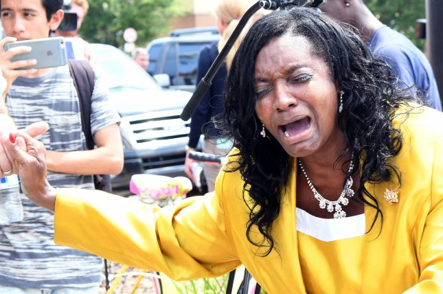 An unidentified mourner cries in downtown Orlando after a lone gunman killed 50 people in a shooting that is being considered an act of terrorism at Orlando's Pulse nightclub early Sunday morning. The shooting was carried out by a single individual who took several people hostage before being killed in shootout with police. Photo by Gary I Rothstein/UPI