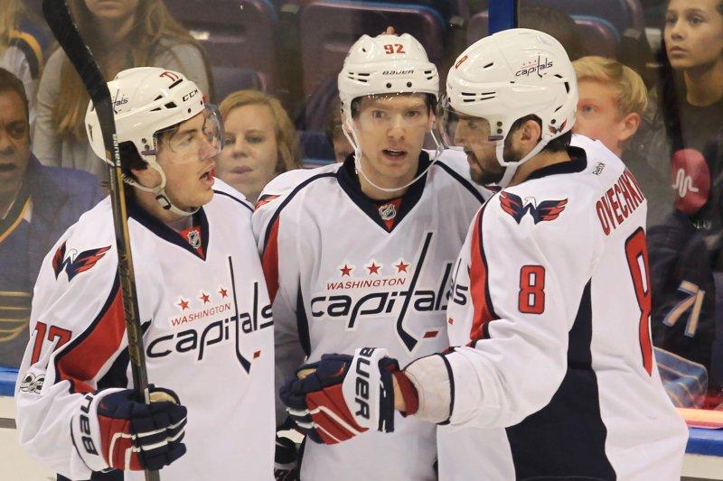 Washington Capitals T.J. Oshie (L) and Alex Ovechkin of Russia (R) congratulate Evgeny Kuznetsov of Russia on his goal. File photo by Bill Greenblatt/UPI