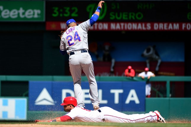 Washington Nationals left fielder Gerardo Parra, shown sliding, went 3-for-3 in a win against the New York Mets on Thursday in Washington, D.C. Photo by Kevin Dietsch/UPI