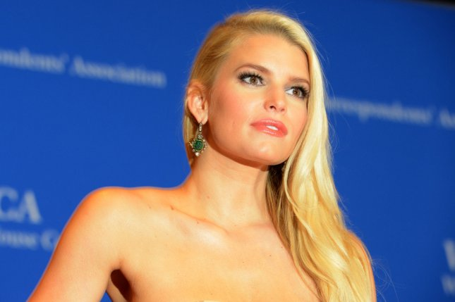 Jessica Simpson will explore the ups and downs of her life and career, including her marriages to Nick Lachey and Eric Johnson, in her first book. File Photo by Molly Riley/UPI