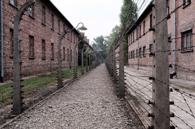 Barbed wire fences divide buildings at the site of the former Auschwitz concentration camp in Oswiecim, Poland. File Photo by Debbie Hill/UPI