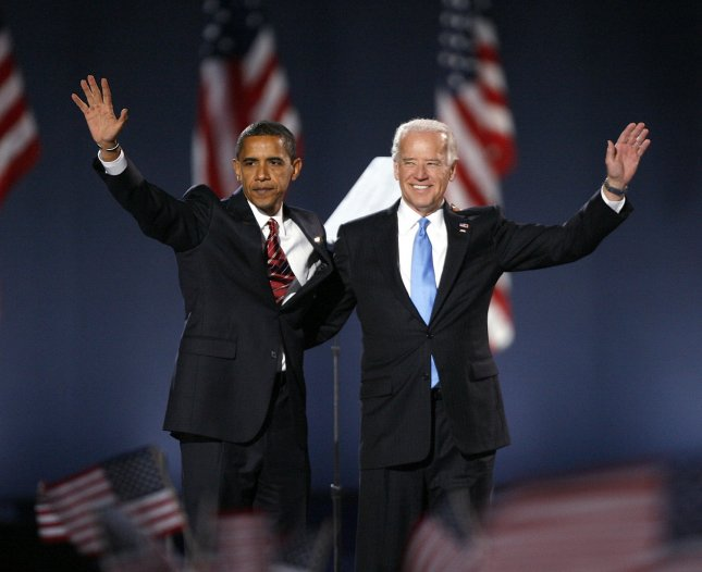 Democratic president-elect Sen. Barack Obama (D-IL) (L) and vice president-elect Sen. Joe Biden (D-DE) wave to supporters at a massive outdoor rally in Grant Park in Chicago on November 4, 2008. Their Republican opponent, Sen. John McCain (R-AZ) and running mate Alaska Gov. Sarah Palin conceded the election in speech to supporters earlier in the evening. (UPI Photo/Brian Kersey)