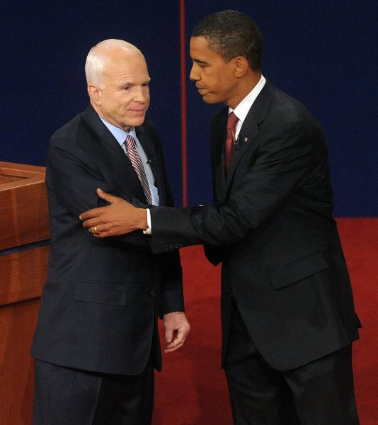 Republican Presidential Nominee Sen. John McCain (AZ) and Democratic Presidential Nominee Sen. Barack Obama (IL) shake hands after the first presidential debate, moderated by journalist Jim Lehrer, at the University of Mississippi in Oxford, Mississippi, on September 26, 2008. The debate went on despite McCain's call for postponement in the face of the current economic crises. (UPI Photo/Roger L. Wollenberg)