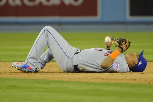 New York Mets' Ruben Tejada lies on the field after a double play with Los Angeles Dodgers Chase Utley, after Tejada fractured his fibula in the seventh inning in game 2 of the National League Division Series against the at Dodger Stadium in Los Angeles on October 10, 2015. Photo by Lori Shepler/UPI