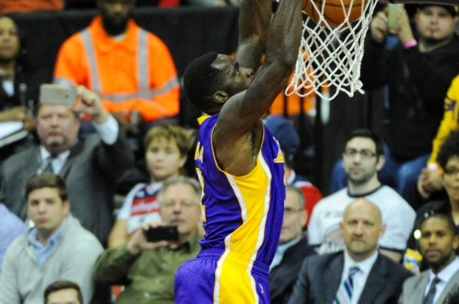 Former Los Angeles Lakers forward Brandon Bass (2) scores on a dunk against the Washington Wizards in the first half at the Verizon Center in Washington, D.C. on December 2, 2015. Photo by Mark Goldman/UPI