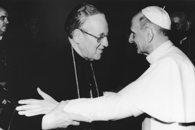 Pope Paul VI embraces Cardinal John Patrick Cody of Chicago on June 20, 1977, in Vatican City after an audience with 80 U.S. cardinals, archbishops and bishops who attended the canonization on June 19 of America's first male Saint John Nepomucene Neumann. The pope died August 6, 1978. UPI File Photo