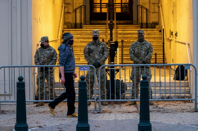 National Guard troops stand guard at the perimeter fence surrounding the U.S. Capitol in Washington, DC Friday. Photo by Ken Cedeno/UPI.