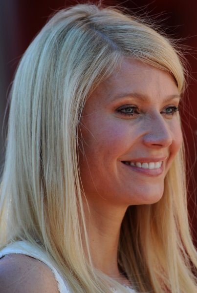Actress Gwyneth Paltrow looks on as singer Tim McGraw makes comments during an unveiling ceremony honoring Paltrow with the 2,427th star on the Hollywood Walk of Fame in Los Angeles on December 1, 2010.UPI/Jim Ruymen