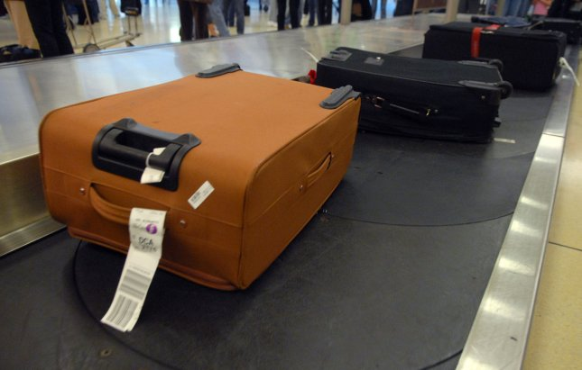 Luggage travels down a baggage claim at at Ronald Regan National Airport in Arlington, Virginia on November 21, 2007. (UPI Photo/Kevin Dietsch)