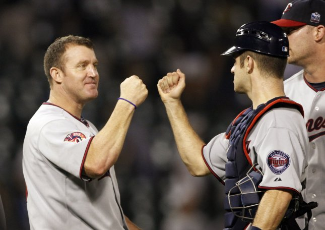 Former Minnesota Twins Jim Thome and Joe Mauer celebrate their win over the Chicago White Sox at U.S. Cellular Field in Chicago on August 10, 2010. The Twins won 12-6. UPI/Brian Kersey