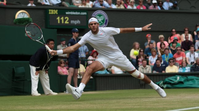 Argentinian Juan Martin Del Potro reurns in his match against Spain's David Ferrer on day nine of the 2013 Wimbledon Championships in London on July 03, 2013. UPI/Hugo Philpott