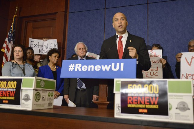 US Sen. Cory Booker (D-NJ) makes remarks at a press briefing to rally support for Congress to renew unemployment insurance benefits, which earlier failed to pass Republican opposition, at the US Capitol, January 16, 2014, in Washington, DC. The boxes in the foreground hold petitions to be delivered to Congressional leaders as labor leaders hold signs to support jobless Americans. UPI/Mike Theiler