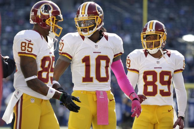 Former Washington Redskins QB Robert Griffin III is surrounded by receivers Leonard Hankerson and Santana Moss (89) during warm ups before the game against the New York Giants in Week 7 of the NFL season in 2012 at MetLife Stadium in East Rutherford, N.J. File photo by John Angelillo/UPI