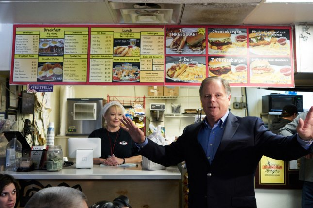 Democratic Senate candidate Doug Jones speaks Monday during a campaign event in Birmingham, Ala. Jones is running against Republican Roy Moore in Tuesday's special election. Photo by Cameron Carnes/UPI